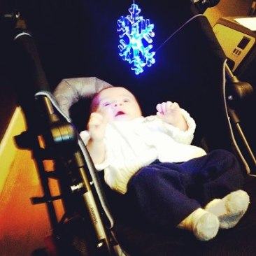 Mallory took this photo of Henry staring at the snowflake light.