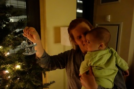 Henry helps mom decide where to put his first ornament.