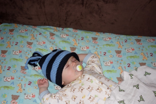 Henry falls asleep wearing his new hat too.