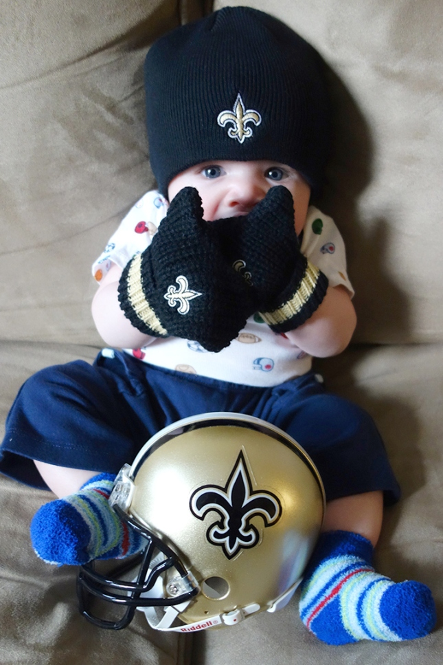 Henry celebrates an overtime victory in the Saints gear his Uncle Chris sent.