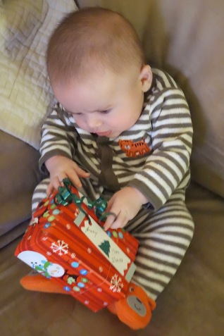 Helping to unwrap a gift from Gram