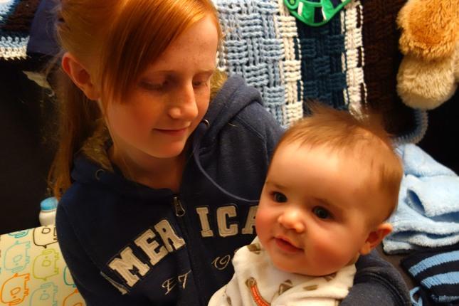 Kaylie holds Henry