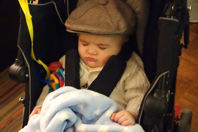 Henry fell asleep on the walk home, but the hat stayed intact-with mom's help, of course.