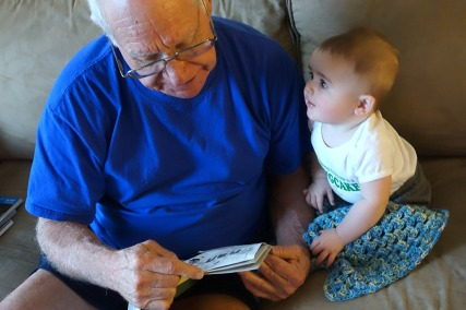 Paw Paw Butch reads a New Yorker cartoon to Henry.