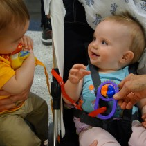 Henry and Mae see each other at the airport. Mae is always smiling.