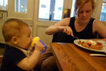 Mom eats a waffle while Henry continues to learn about the sippy cup.