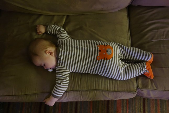 After swimming and going to the park, Henry goes down for the night. He sleeps on his stomach more often now.