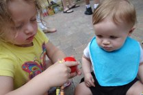 Madison, Dina's daughter, takes care of Henry and helps him figure out how to maneuver the toy.