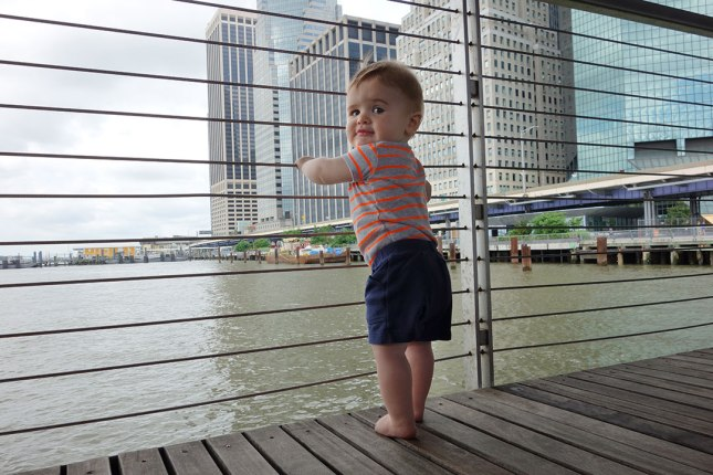Henry looks out at the East River from a pier in Lower Manhattan.