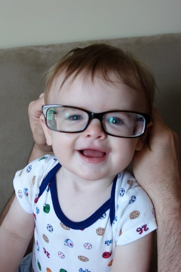 Trying on Dad's glasses.