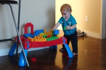 Henry playing with his mega-blocks.