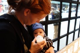 Mom feeds Henry at the falafel restaurant.