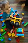 Henry enjoys his new dump truck that will help transport blocks.