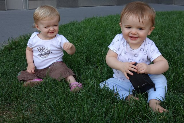 Isla and Henry pose on a grassy knoll near Asphalt Green (more like a big planter with grass in it).