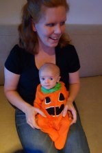 Henry in his Jack-O-Lantern costume with Mom at Gavin's Halloween party.