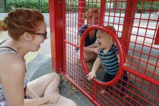Peeking through a portal at the playground.