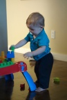Henry stacking blocks.