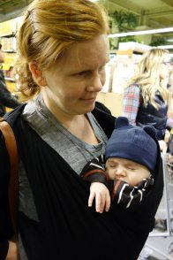 Henry and mom stand in line at Whole Foods.