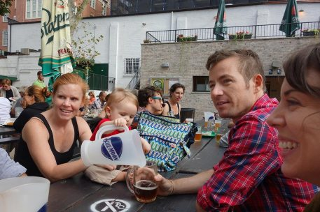 Henry tops off Eamonn's beer.