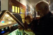 Paw Paw Butch and Henry make a selection on the jukebox at Mosca's.