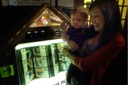 Aunt Cheryl and Henry enjoy the jukebox at Mosca's.
