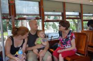 Jacqui, Mark, Henry and Grandma Lois take a ride on a streetcar.