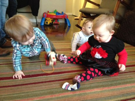 Henry and Reagan play while Hudson crawls. (Photo courtesy of Dina Lindner).