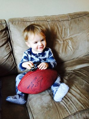 Henry poses with his Drew Brees autographed football, a gift from Uncle Chris.