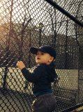 Grabbing the chain-link fence at James J. Walker Park.