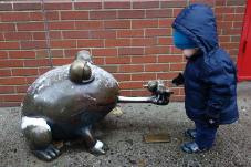 Henry sees the frog statue outside PS 234.