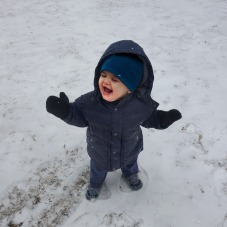 Laughing in the snow.