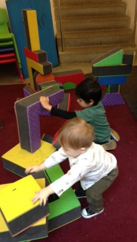 Henry and Egon play with blocks.