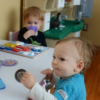 Henry and Hudson play at the table.