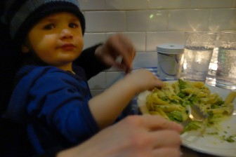 Henry shares penne pasta and broccoli with mom.