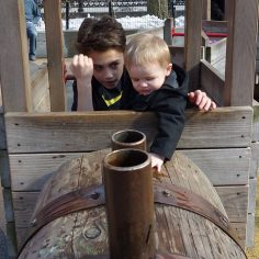 Jacob and Henry play in the train.