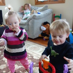 Henry and Reagan play while Madison sits in the background.