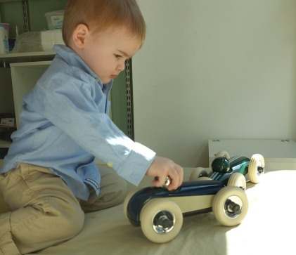 "Henry plays with the first toys I ever bought for him: a set of Playforever ""Bonnie"" and ""Clyde"" race cars."