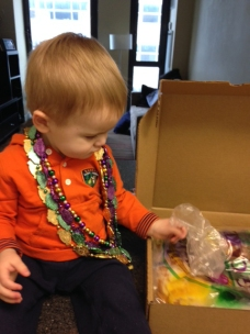 Henry examines the king cake his Paw Paw Butch sent…