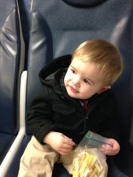 Henry on NJ Transit eating Veggie Sticks.