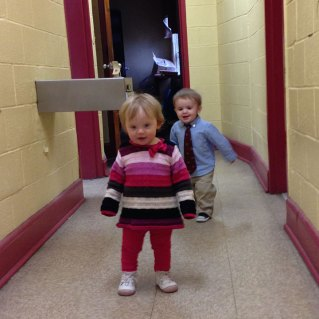 Henry and Reagan play in the hall.