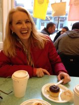 Suzanne eating the first of two cupcakes at Billy's Bakery.