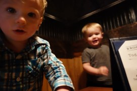 Hudson and Henry share a booth at The Brooklyneer.