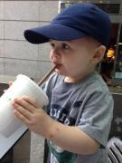 Henry drinks his chocolate shake.