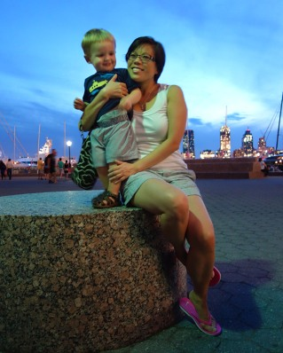 Henry and Aunt Mimi sit by the Hudson River.