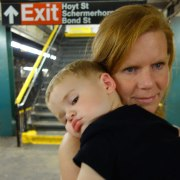 Henry rests on his mom's shoulder on the way home from Brooklyn.