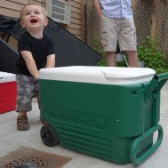 Henry attempts to move the ice chest.
