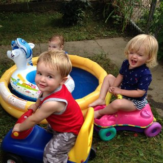 Henry with Vera (in pool) and Isla (on bike).