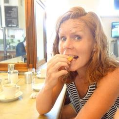 Jacqui enjoys a bite of beignet.