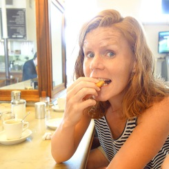 Jacqui enjoys a bite of beignet.