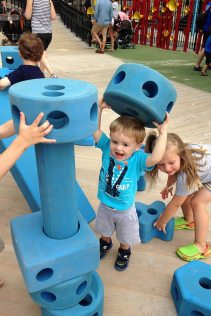 Henry plays with the blocks at Imagine Playground.